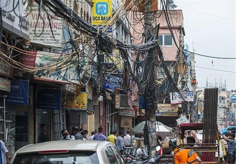 زندگی مردم دهلینو میان کابلهای برق+عکس